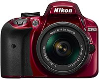 Nikon D3400 24.2 Megapixel Digital SLR Camera with Lens - 18 mm - 55 mm - Red - 3' LCD - 16:9 - 3.1x Optical Zoom - Optical (IS) - TTL - 6000 x 4000 Image - 1920 x 1080 Video - HDMI - HD Movie Mode -